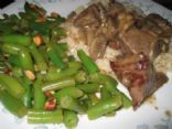 Beef tips with mushrooms, green bean almandine and brown rice