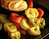 Tortellini with roasted garlic sauce