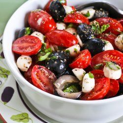 Tomato, Olive, and Mozzarella Salad with Basil Vinaigrette Recipe ...