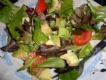 Mixed greens with avocado, nuts and raisins