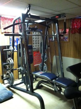 Heres Another View Of The Weight Machine You Can See One Montes Beds Next To It He Has A Bed In Our Living Room Office And Basement