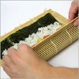 4. Roll up the sushi into a cylinder.