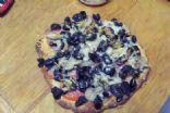 Black olive, mushroom pizza