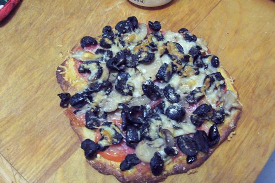 Black olive, mushroom pizza