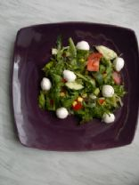 Mixed green leaf salad with tomato, corn, peppers