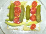 Advocado,Cottage Cheese,Chopped Chives,Gherkins and Cherry Tomatoe's on Corn Cruskies