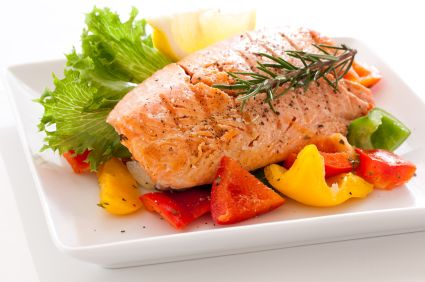 Baked Salmon on a bed of tomato & spring onion, with lemon and chilli