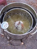 Deep Fried Turkey ~ Removing The Turkey From the Hot Oil